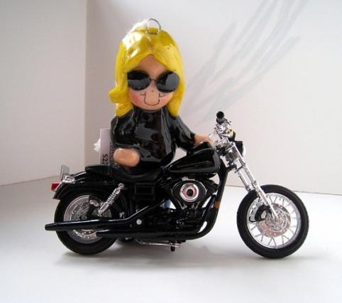plastic santa on motorcycle