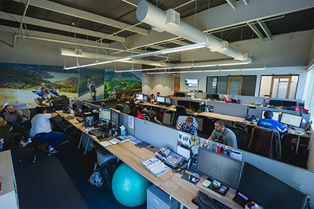 The MotoSport office's open floor plan encourages collaboration among employees