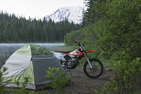 A scenic lakeside and views of Mt. Adams while motorcycle camping are a few of the benefits of living in the Pacific Northwest